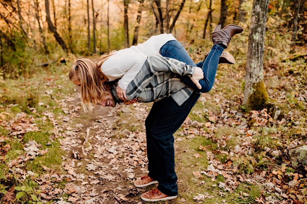 Adventurous & Fun Engagements session at Interstate State Park, Wisconsin // Piggy Back Ride